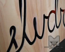 Water jet cut Birchwood Panels with Logo for SLVDR Cothing - Store Front Display