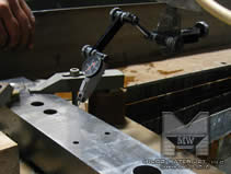 Advantages to Waterjet cutting - MILCO Waterjet - Setting up a part without mechanical stress